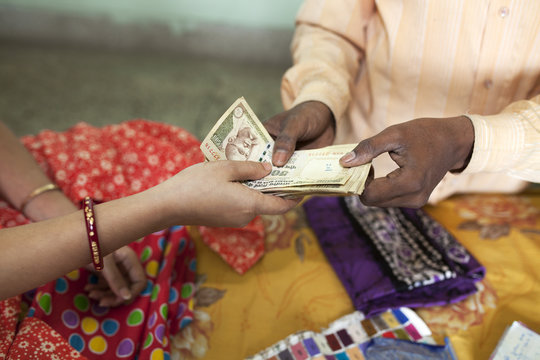 Small businessman accepting money from customer
