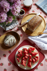 Good afternoon tea time, bread, food and fruit on the table