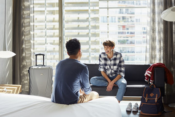 Cheerful Woman Talking With Man In Hotel Room