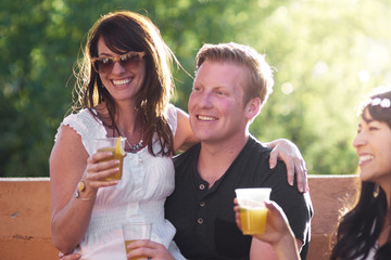 A couple in love at a summer party with a cocktail