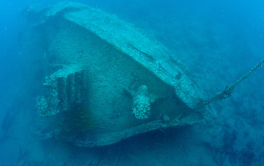 A wrecked tugboat in tropical waters.