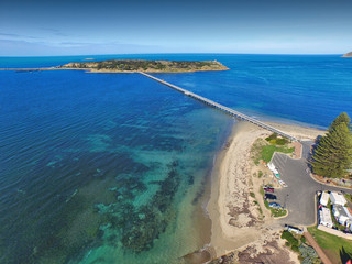 Granite Island causeway jetty at Victor Harbor (Harbour) South Australian Tourism Holiday Hot Spot, featuring horse drawn carriage cart wagon and calm water blue bay scenes
