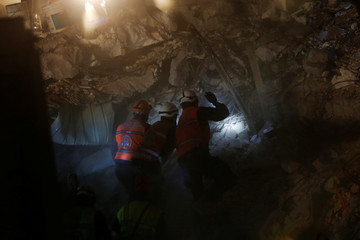 Rescue workers work on a collapsed building after an earthquake at the Obrera neighborhood in Mexico City