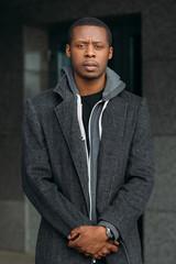 Distrustful African American male. Urban fashion. Suspicious black man, facial expression, stylish concept