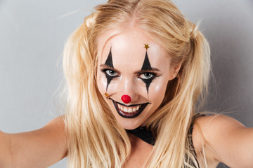 Close up portrait of a cheerful joyful blonde woman