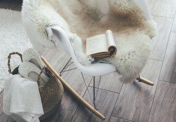 Rocket chair with sheep skin rug in scandinavian living room