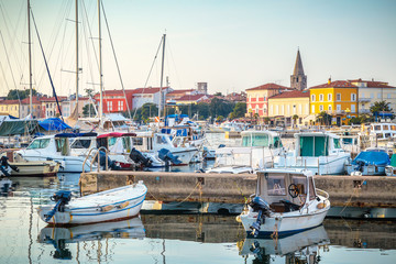 Harbor with docked boats in Porec town on Adriatic sea in Croatia, Europe.