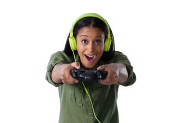 Woman making funny faces while playing video games