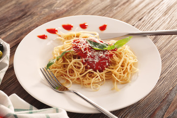 Delicious pasta with tomato sauce on plate