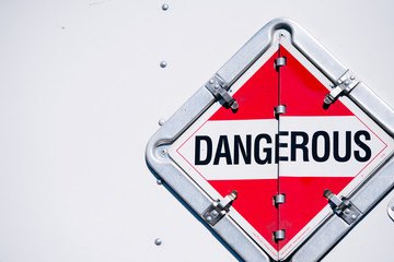The sign dangerous in the safety box on the semi trailer wall Wall mural