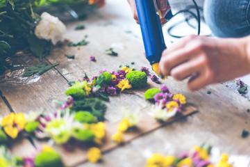 Florist making flower decoration