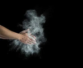 male powerlifter hand in talc splash preparing to work hard