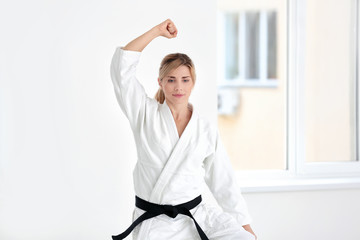Female karate instructor training in dojo