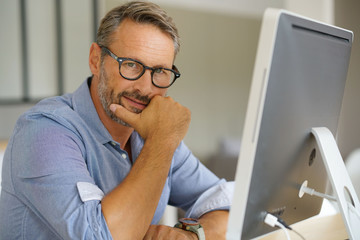 Businessman working on desktop computer