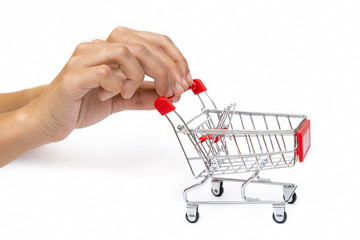 Hands Pushing Miniature Shopping Cart, Isolated On White Background