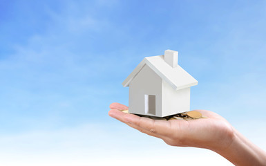 salesman person giving to buyer customer,house in hand