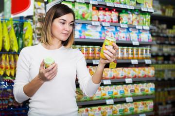 Woman choosing healthy baby food