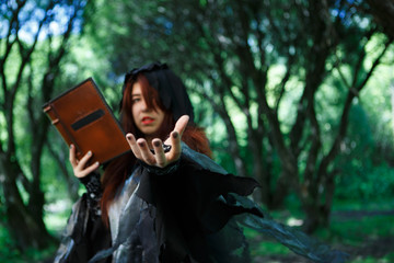 Mystic witch with spell book