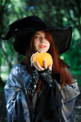 Close-up picture of witch with pumpkin
