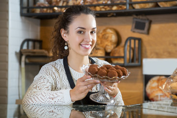 Female chef holding chocolate candy