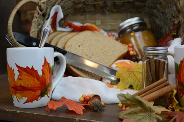Autumn food set with tea, cup bread, and jelly