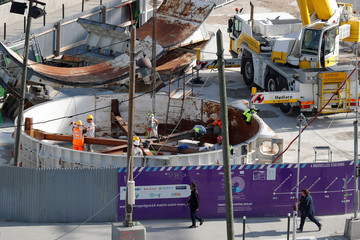 "Workers are seen on the site of the future metro station ""Porte de Clichy"" in Paris"