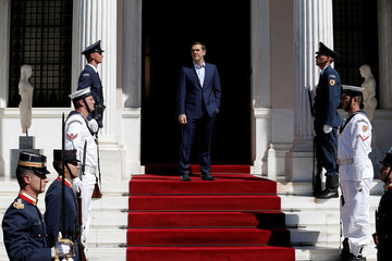 Greek PM Tsipras waits to welcome French President Macron at the Maximos Mansion in Athens