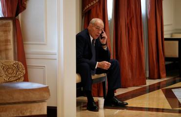 White House Chief of Staff John Kelly on his phone as U.S. President Donald Trump meets with Ukraine President Petro Poroshenko in New York