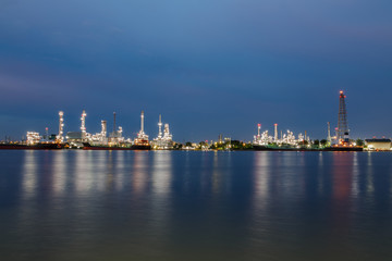 Oil refinery at night with lighting  beautiful in Bangkok Thailand