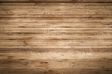 Old scratched wooden cutting board as background