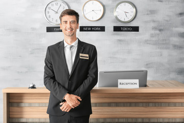 Male receptionist working in hotel