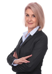 old smiling businesswoman with arms crossed