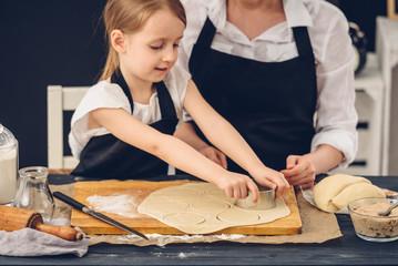 Mom and daughter preparing dumplings in the kitchen