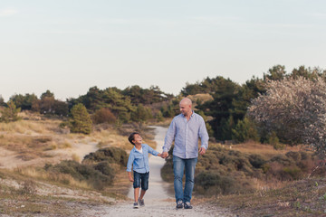 Father and son enjoying a walk in the dunes