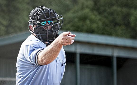 Umpire in blue uniform calls a strike