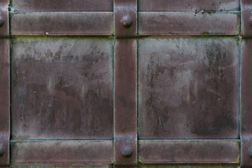 Background of wrought iron with rivets and metal stripes. Dirty steel texture. The background of the castle gate.