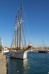 Old sailing ship in port of Barcelona