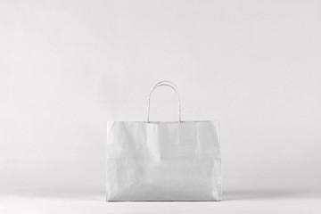 Grey shopping bag on  background