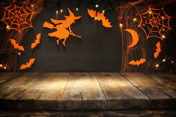 Empty rustic table in front of Halloween holiday background. Ready for product display montage