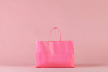 Pink shopping bag on pink background