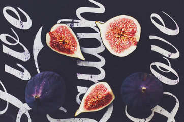 Ripe purple figs on black background