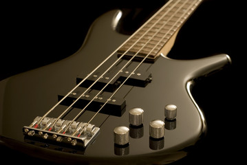 Electric Bass Guitar on Black Background