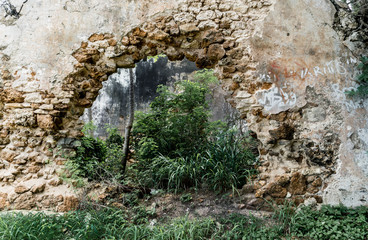 Hole in wall of abandoned stone building