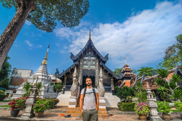 Tourist in Wat Chiang Man temple in Chiang Mai, Thailand.