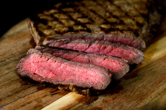 rare steak wooden cutting board