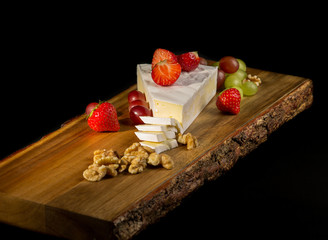 Brie cheese on a chopping board.