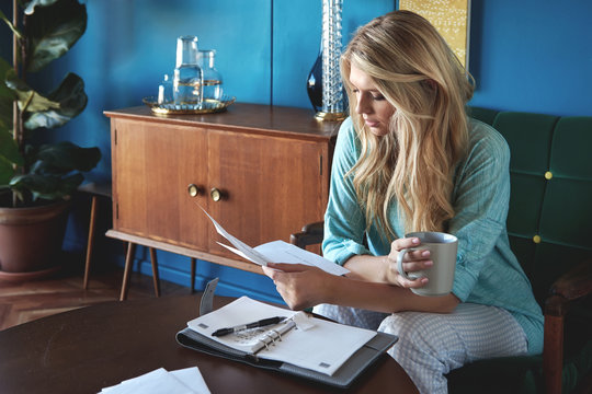 Woman at home doing her budgeting monthly bills