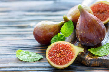 Half ripe sweet figs and whole fruits.