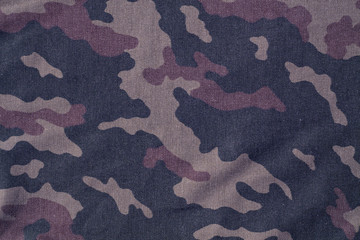 Textile camouflage uniform color background pattern.