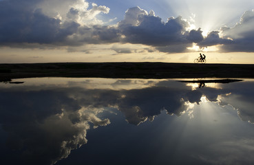 Brothers cycling in a wonderful landscape